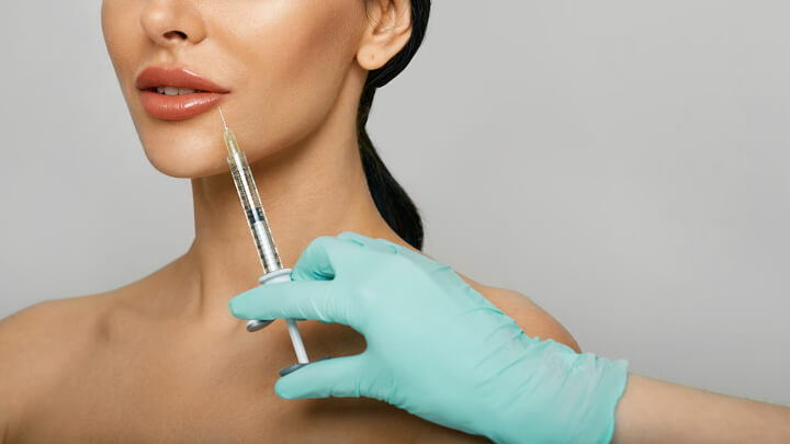 woman received botox injection in her lips