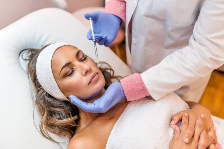 woman receiving botox injection in her cheek